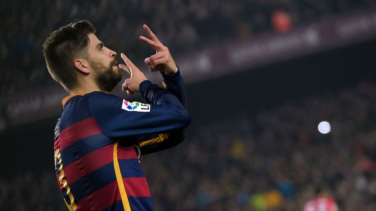 Gerard Pique celebrates after putting Barcelona ahead in the second half