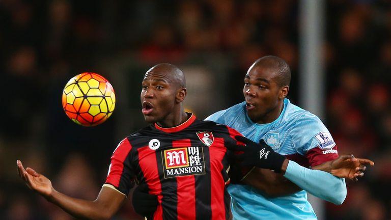 Benik Afobe of Bournemouth holds off Angelo Ogbonna Obinza of West Ham United