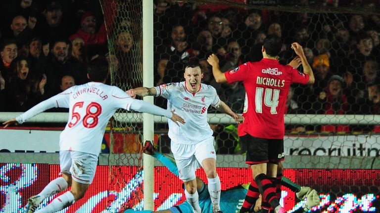 Brad Smith's goal ensured Liverpool remained in the FA Cup following a 2-2 draw with Exeter City