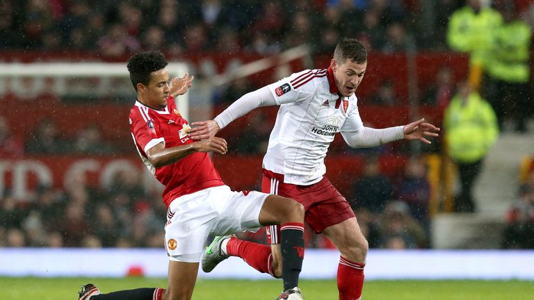 Manchester United's Cameron Borthwick-Jackson and Sheffield United's Paul Coutts
