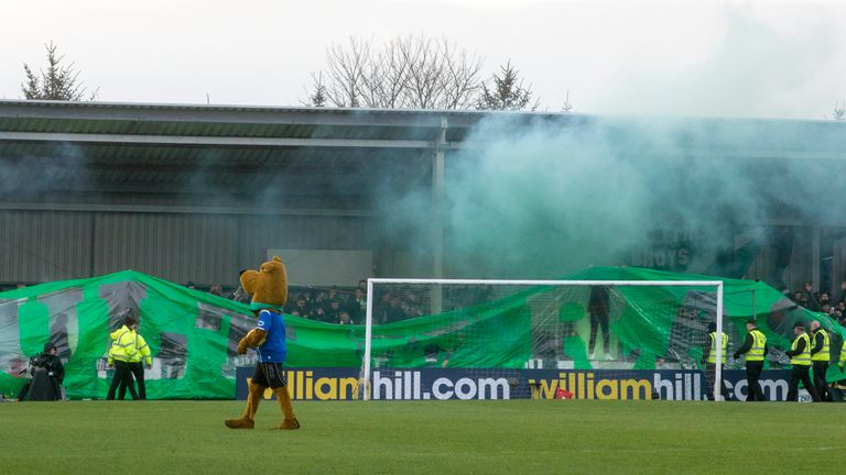 Flares set off in the stands before kick off during Celtic's Scottish Cup, Fourth Round match at Stair Park, Stranraer