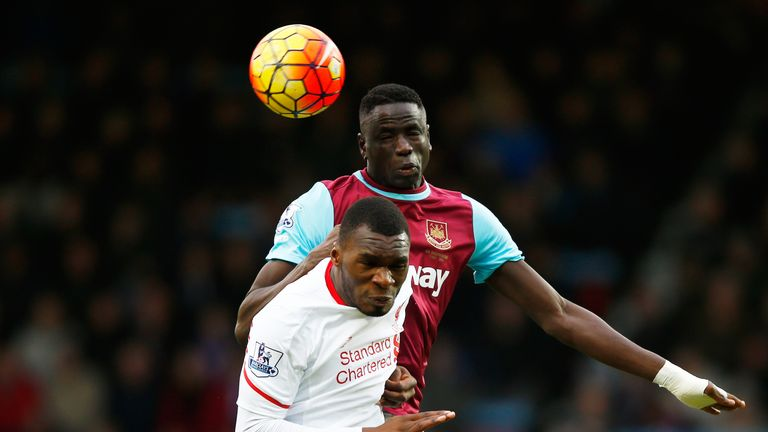 Cheikhou Kouyate of West Ham United and Christian Benteke of Liverpool compete for the ball during the Premier League match at Boleyn Ground in 2016