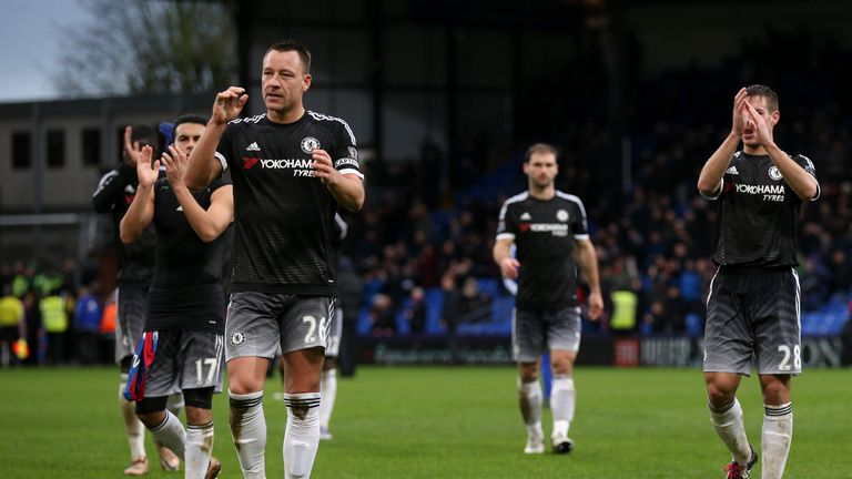 John Terry of Chelsea and his team-mates applaud the fans