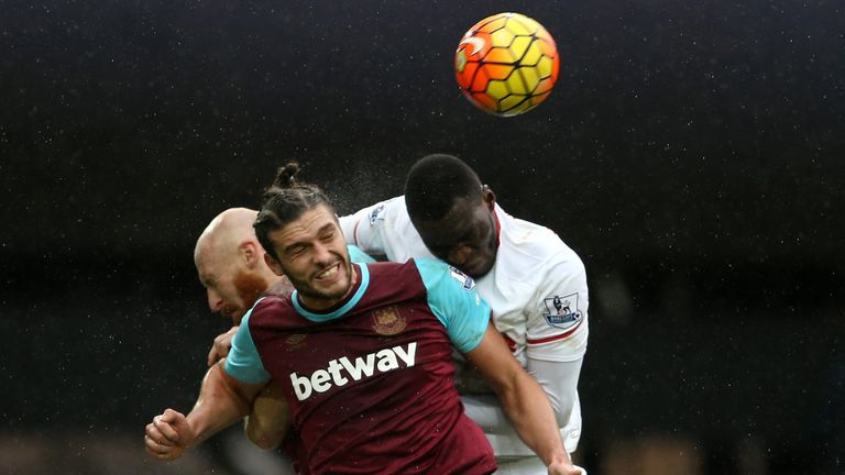 Liverpool's Christian Benteke (R) vies with West Ham United's James Collins and Andy Carroll (C) at the Boleyn Ground in January 2016