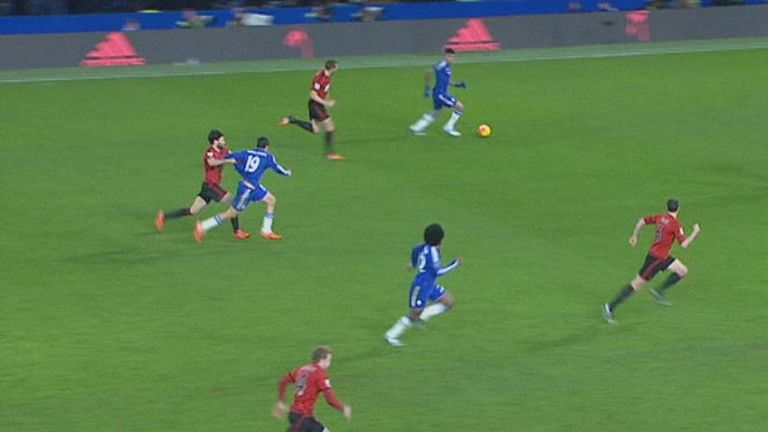 Claudio Yacob (left) pulls back Diego Costa as Chelsea attack