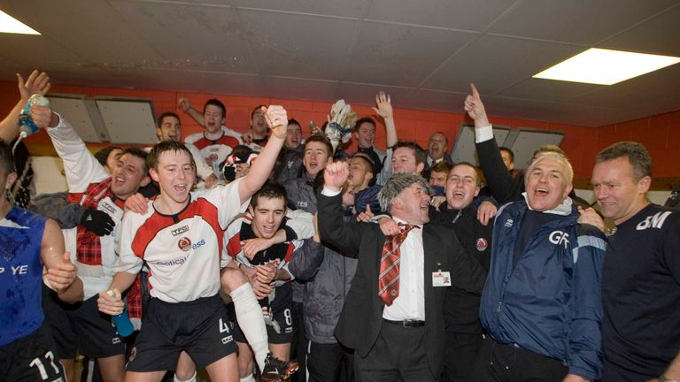 Clyde manager Graham Roberts (2nd from right) leads his squad in the dressing room celebrations.