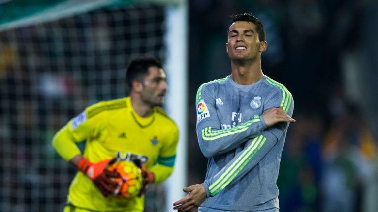 Cristiano Ronaldo (R) reacts as he fail to score ahead goalkeeper Antonio Adan of Real Betis