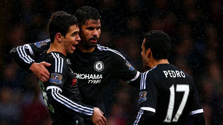 Oscar celebrates his goal with Diego Costa and Pedro