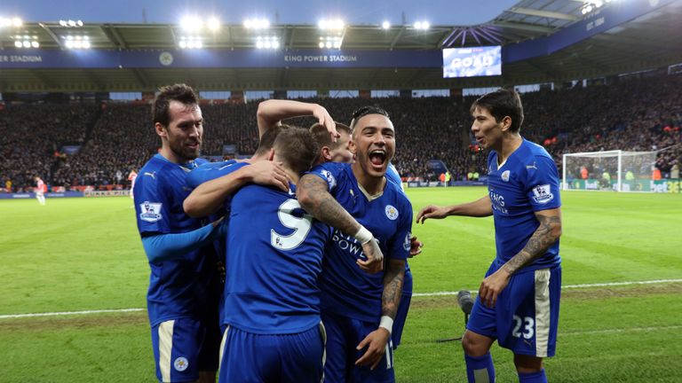 Danny Simpson celebrates with goal-scorer Jamie Vardy