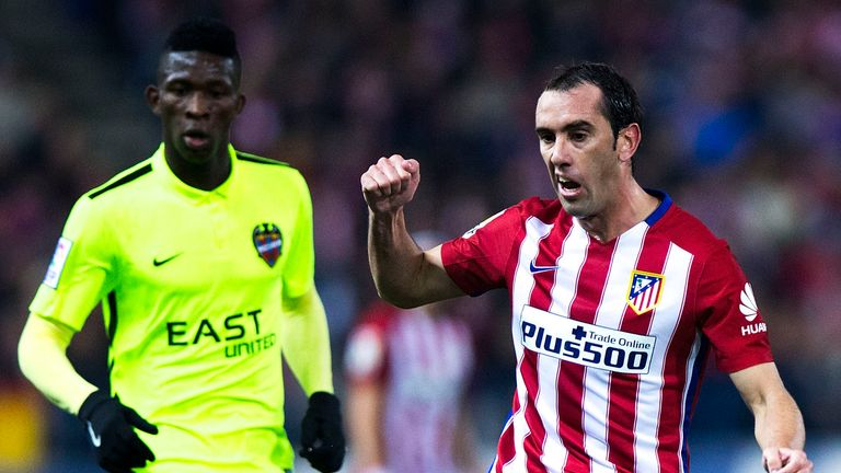 Diego Godin competes for the ball with Jefferson Lerma