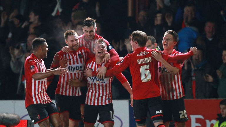 Exeter City's Lee Holmes celebrates with teammates after scoring his sides second goal of the game during the Emirates FA Cup, third round match at St Jame