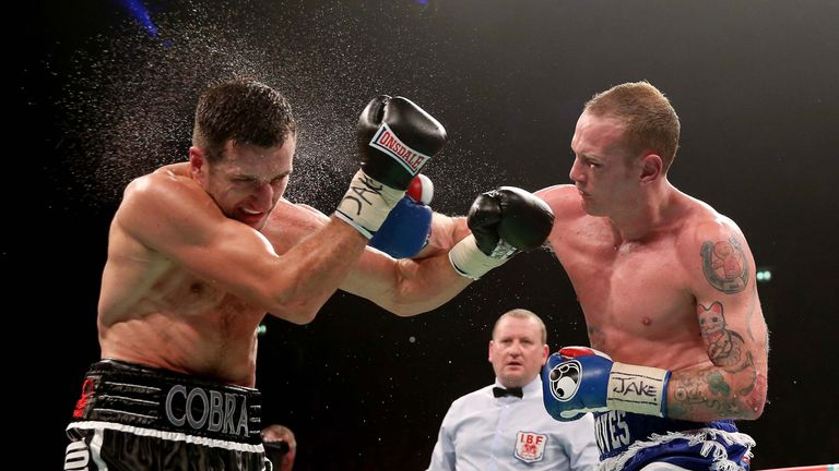 Carl Froch (L) in action with George Groves first fight