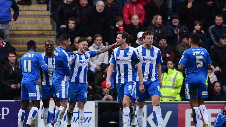 George Moncur (4th L) of Colchester United celebrates scoring his team's first goal