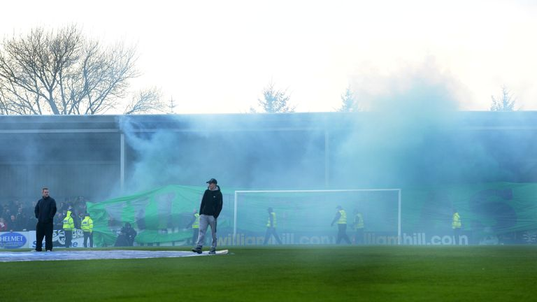 A green flare is let off ahead of Celtic's Scottish Cup tie at Stranraer