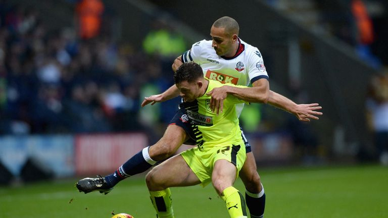 Harry Bunn of Huddersfield Town is challenged by Darren Pratley of Bolton