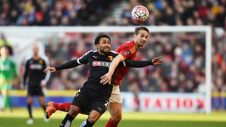 Ikechi Anya of Watford and Chris Cohen of Nottingham Forest compete for the ball during The Emirates FA Cup fourth round