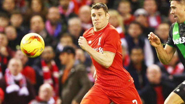 Liverpool midfielder James Milner (left) wins the race for the ball against Stoke