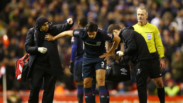 James Tomkins was forced off with a head injury after a clash with Joe Allen