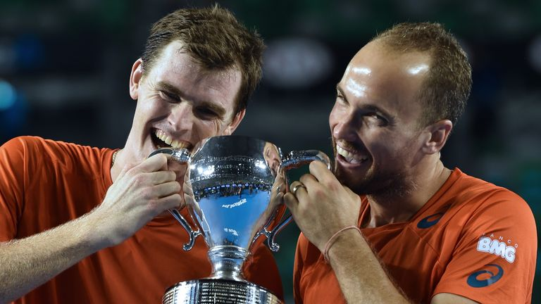 Britain's Jamie Murray (L) and Brazil's Bruno Soares pose with the trophy after victory in the Australian Open men's doubles