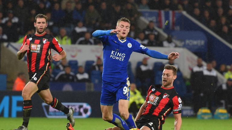 Leicester's Jamie Vardy is fouled by Simon Francis of Bournemouth resulting in a penalty and a red card for Francis