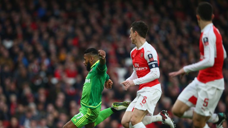 Jeremain Lens scores against Arsenal in the FA Cup