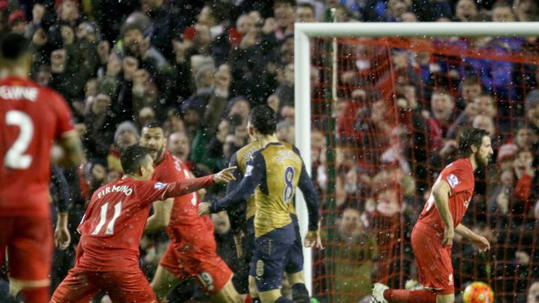Liverpool's Joe Allen scores his side's third goal of the game