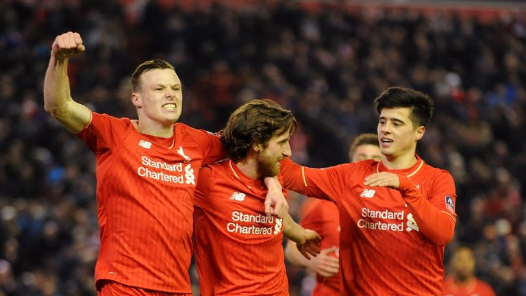 Joe Allen (c) of Liverpool is congratulated after his goal during the FA Cup third round replay against Exeter