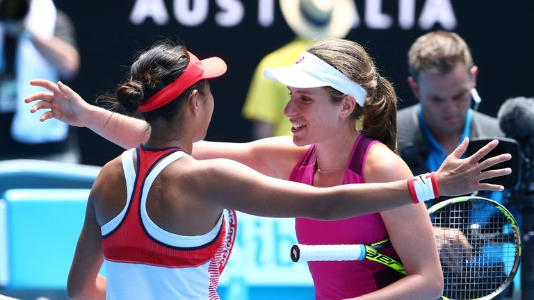 Konta and Zhang embrace after their quarter-final clash
