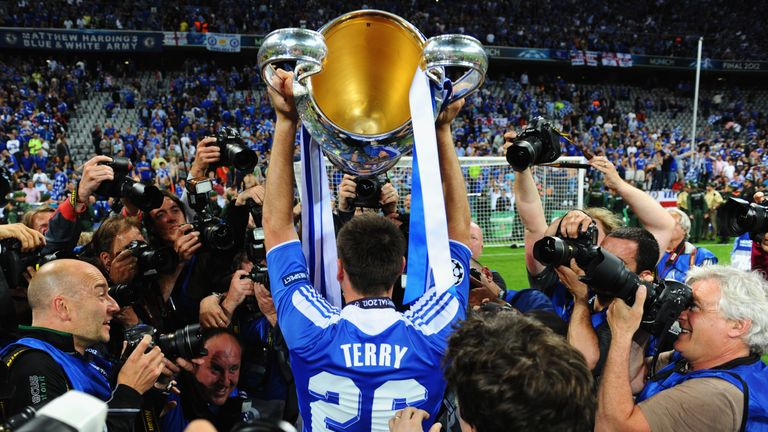 Terry lifts the Champions League trophy in 2012 after missing the final through suspension