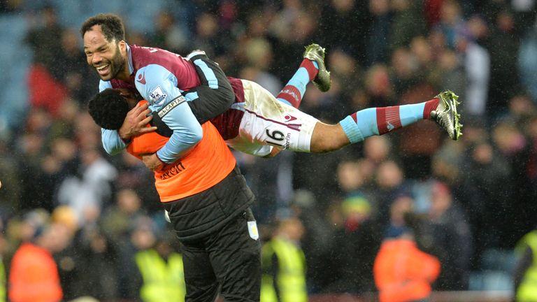 Aston Villa's English defender Joleon Lescott (top) celebrates after winning the match against Crystal Palace