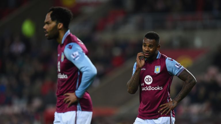 Aston Villa players Joleon Lescott (L) and Leandro Bacuna react during the Barclays Premier League defeat to Sunderland