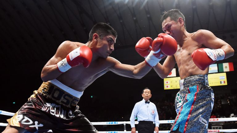 Mexican challenger Jose Argumedo (left) lands his left hook on Katsunari Takayama (right)