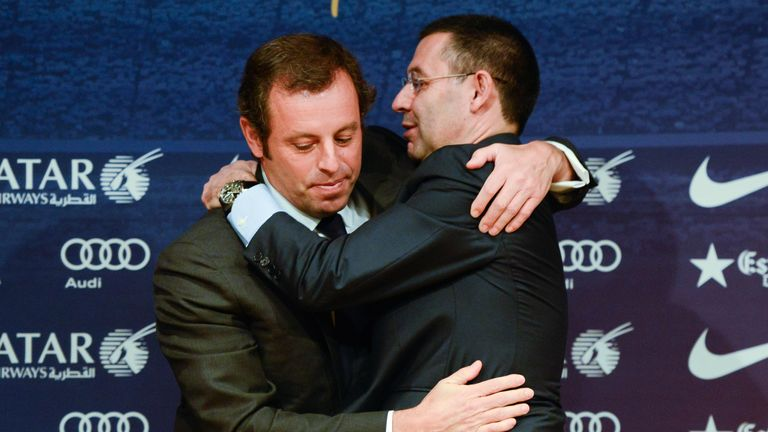 BARCELONA, SPAIN - JANUARY 23:  FCB Vice-President Josep Maria Bartomeu (R) hugs FCB President Sandro Rosell after the press conference announcing his resg