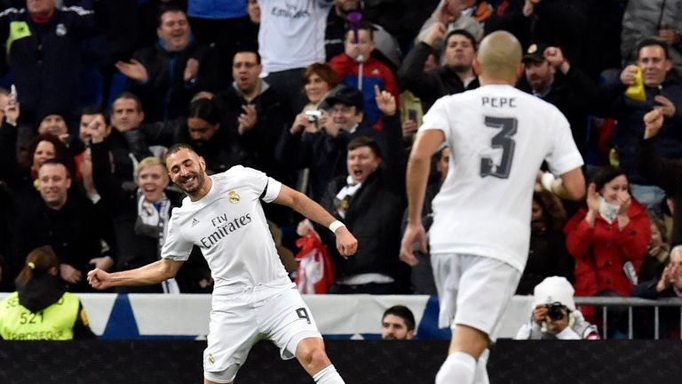 Karim Benzema (left) celebrates after scoring Real's first goal