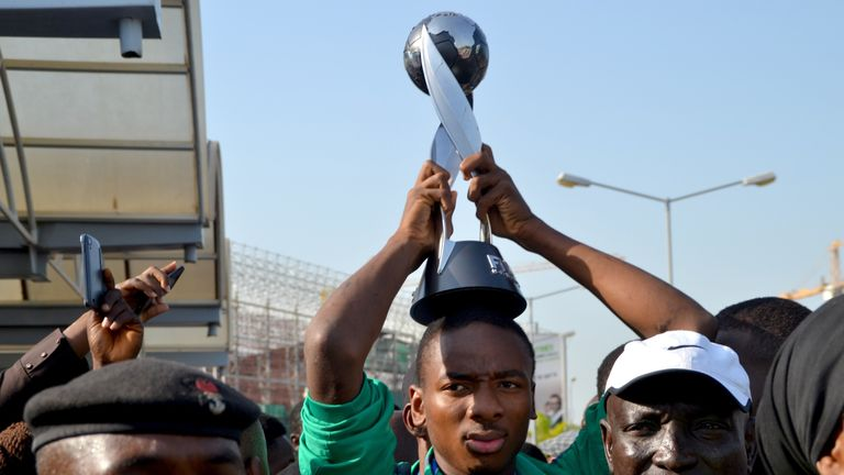 Nigeria's Kelechi Nwakali carries the Fifa Under-17 World Cup trophy on his head in the midst of a crowd