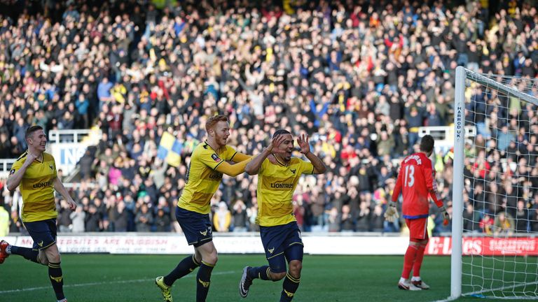 Oxford United's English midfielder Kemar Roofe (2R) celebrates scoring his team's second goal during the FA