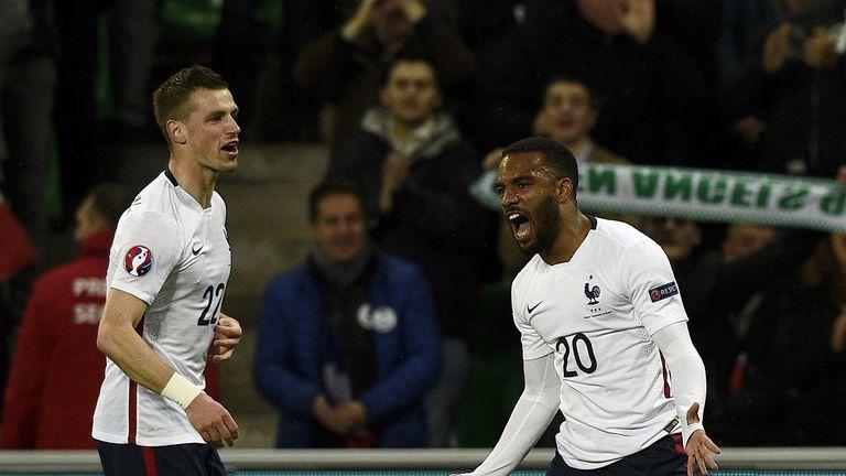 France forward Alexandre Lacazette (R) celebrates next to midfielder Morgan Schneiderlin after scoring a goal against Denmark