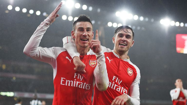 Laurent Koscielny celebrates after scoring in Arsenal's 100th 1-0 win in the Premier League