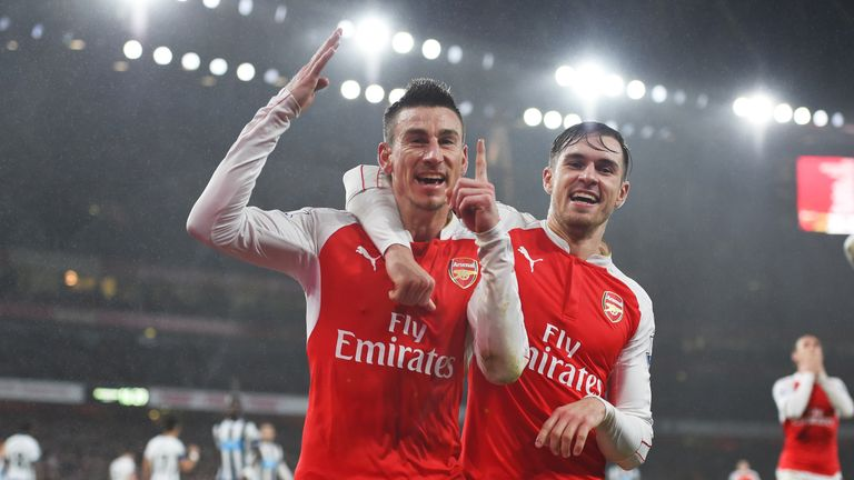 Laurent Koscielny (L) celebrates putting Arsenal 1-0 up against Newcastle, with his team mate Aaron Ramsey (R)