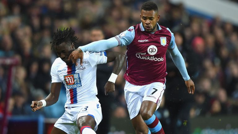 Pape N'Diaye Souare of Crystal Palace holds off Aston Villa's Leandro Bacuna