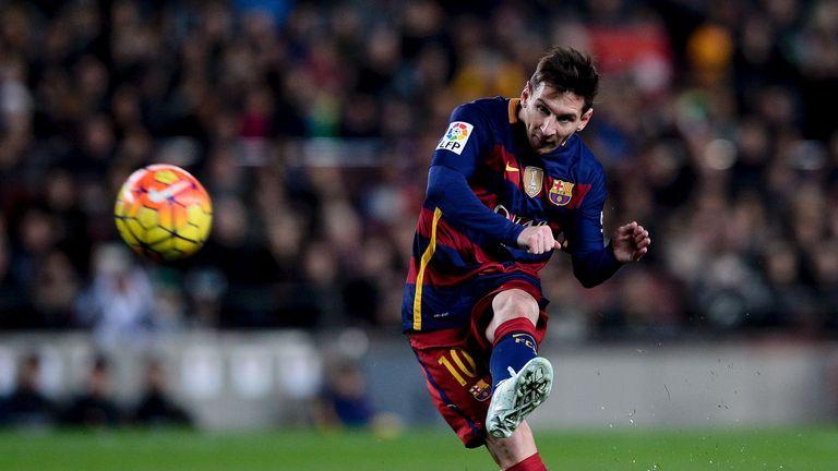 Lionel Messi takes a free kick