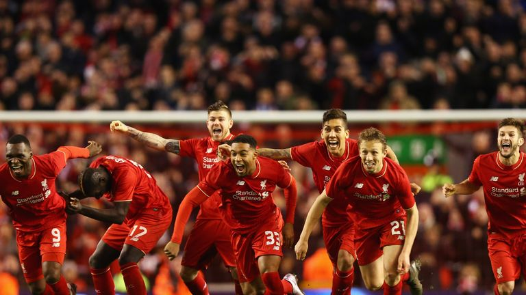 Liverpool players celebrate after Joe Allen scores the winning penalty against Stoke