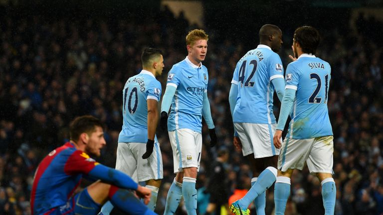 Sergio Aguero of Manchester City celebrates with team-mates after scoring his team's third goal