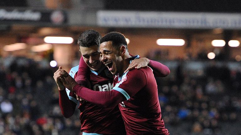 Burnley's Matthew Lowton celebrates with team-mate Andre Gray (right) after scoring the fourth goal v MK Dons