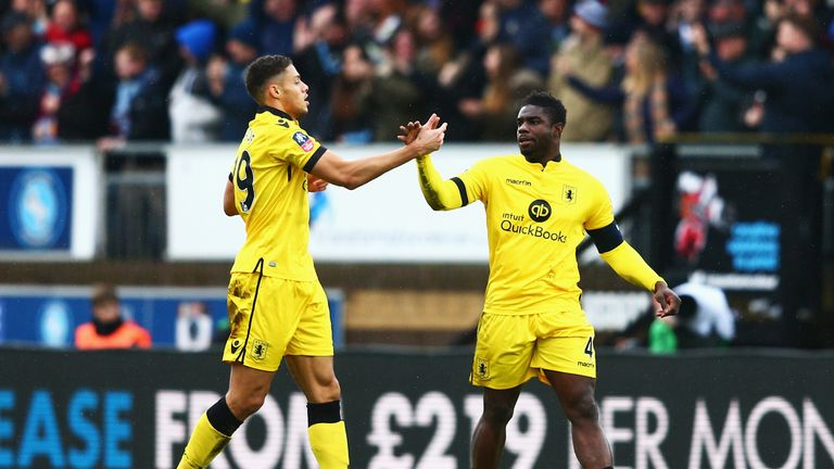 HIGH WYCOMBE, ENGLAND - JANUARY 09: Micah Richards (R) of Aston Villa celebrates scoring his team's first goal with his team mate Rudy Gestede (L)