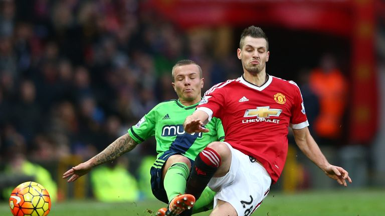 Morgan Schneiderlin of Manchester United and Jordy Clasie of Southampton crunch into a tackle