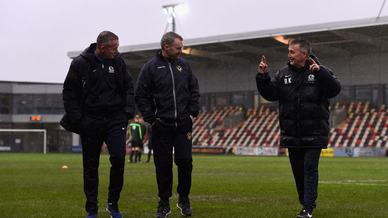 Newport manager John Sheridan (centre) inspects the waterlogged pitch with Blackburn manager Paul Lambert (left)