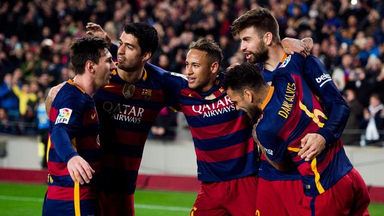 Lionel Messi, Luis Suarez, Neymar Santos Jr and Dani Alves of FC Barcelona celebrate with their teammate Gerard Pique (R)