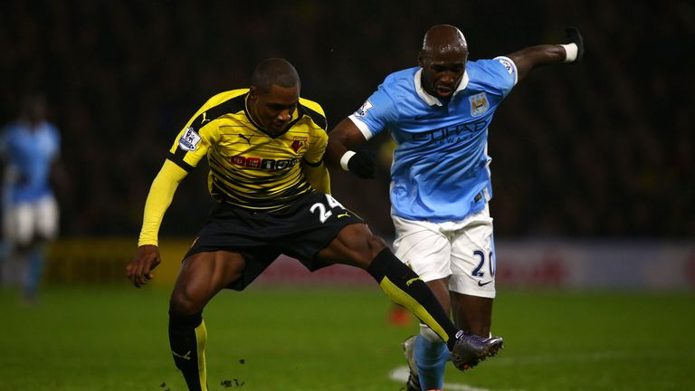 Odion Ighalo of Watford (L) battles for the ball with Eliaquim Mangala of Manchester City during the Premier League match at Vicarage Road in January 2016