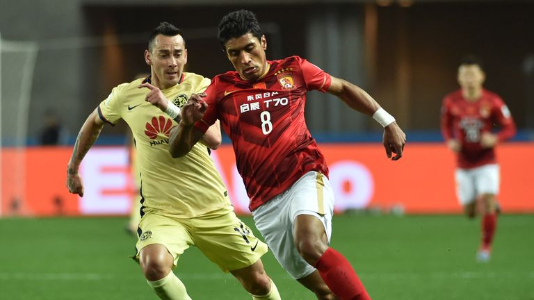 Paulinho (R) lifted the Chinese Super League title with Guangzhou Evergrande in his first season